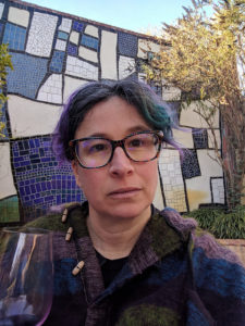 liz in front of mosaic wall