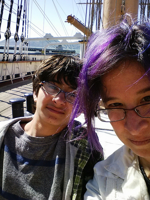 liz and milo on a wooden ship